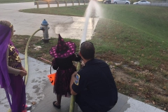 Kids play with firehose